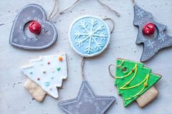 Diversity of Christmas toys - wooden toys and gingerbread cookies in the different shapes. Top view, flat lay Royalty Free Stock Photo