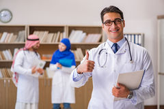 The diversity concept with doctors in hospital Stock Photo