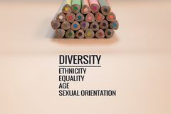 Diversity concept. row of mix color pencil on black background with text Diversity, Ethnicity, Equality, Age, Sexual Orientation Royalty Free Stock Photography