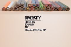 Diversity concept. row of mix color pencil on black background with text Diversity, Ethnicity, Equality, Age, Sexual Orientation Stock Images