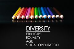 Diversity concept. row of mix color pencil on black background with text Diversity, Ethnicity, Equality, Age, Sexual Orientation stock photo