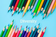 Diversity concept. row of mix color pencil on blue background royalty free stock photography