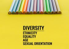Diversity concept. row of mix color pencil on yellow background with text Diversity, Ethnicity, Equality, Age, Sexual Orientation royalty free stock images