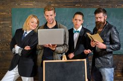 Diversity concept. School staff. People with laptop book stand in school classroom. School teachers. Bearded man. Diversity concept. School staff. People with royalty free stock photos