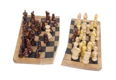 Diversity divided. Shown by chess pieces on a broken wooden chess board - path included Stock Photography