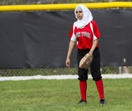 Diversity In  Girls High School Fastpitch Softball And Other Sports. A female fastpitch softball player wearing a burka during a Beech Grove vs Park Tudor Stock Photography