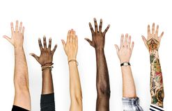 Diversity hands raised up gesture stock photos