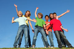 Diversity kids group hands raised. Diversity kids or childrens group hands raised stock images