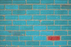 Free Diversity Light Blue Wall With One Red Brick Stock Image - 103630371