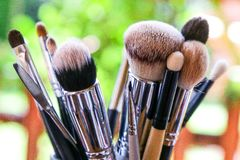 A bunch of makeup brushes, clear captured on a blurred background royalty free stock photos