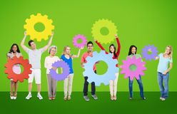 DIversity People Holding Cog Collaboration Cheerful Concept Stock Images