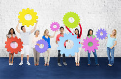 DIversity People Holding Cog Collaboration Cheerful Concept Royalty Free Stock Photography