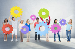 DIversity People Holding Cog Collaboration Cheerful Concept Stock Photography