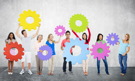 DIversity People Holding Cog Collaboration Cheerful Concept Stock Photo