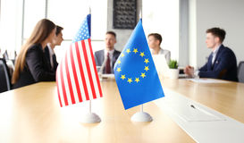 Diversity people talk the international conference partnership. American flag and European Union flag. Stock Photography