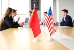 Diversity people talk the international conference partnership. Chinese flag and American flag. Stock Images