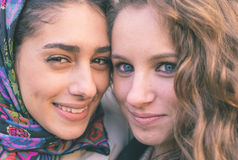 Diversity. Portrait with two girls from different ethnicity. Muslims and christians people perfectly integrated Stock Images