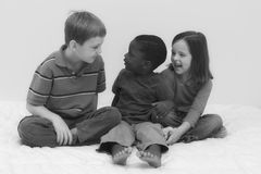 Diversity Series. Three young children playing together Royalty Free Stock Photos