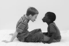 Diversity Series. Two young boys of different races playing together Stock Image
