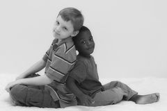 Diversity Series. Two young boys of different races playing together Stock Photos