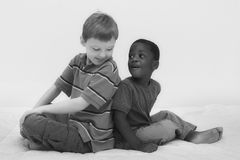 Diversity Series. Two young boys of different races playing together Royalty Free Stock Photo