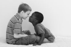 Diversity Series. Two young boys of different races playing together Royalty Free Stock Images
