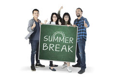 Diversity students hold a text of summer break Royalty Free Stock Photos