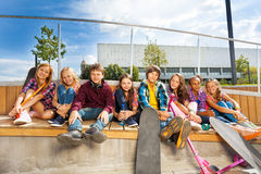 Diversity of teens with skateboards and scooter Royalty Free Stock Image