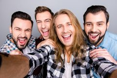 Diversity virility masculinity spend funtime concept. Close up p. Hoto of four excited enthusiastic astonished amazed friendly guys taking selfie checkered jeans Royalty Free Stock Photography