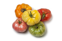 Diversity of whole Beefsteak Tomatoes. On white background stock images