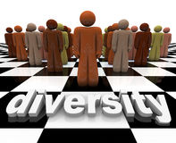 Diversity - Word and People on Chessboard. The word Diversity on a chessboard with a line-up of many people of different races Royalty Free Stock Photos