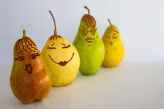 Diversity of the world. Various pears. Yellow, green, red. Round, tall, small. Choose your girlfriend. Light background. Figure made by the author royalty free stock image
