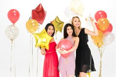 Young women have fun together at party stock image