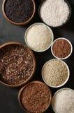 Diverso arroz en cuencos Imagenes de archivo