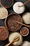 Diverso arroz en cuencos Imagen de archivo