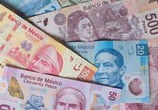Diverso fondo mexicano del dinero Fotos de archivo