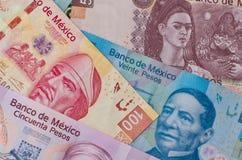 Diverso fondo mexicano del dinero Fotografía de archivo
