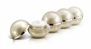 Diverso frasco cosmético da esfera dourada no branco Imagens de Stock Royalty Free