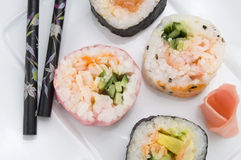 Diverso sushi con el jengibre y los palillos Fotografía de archivo libre de regalías