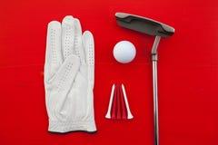 Diversos equipos de golf en el escritorio Fotos de archivo libres de regalías