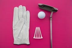 Diversos equipos de golf en el escritorio Imagen de archivo libre de regalías