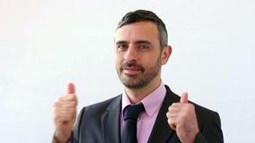 Diversos gestos de los hombres de negocios en un traje almacen de metraje de vídeo