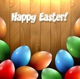 Diversos huevos de Pascua en un fondo de madera Fotos de archivo libres de regalías