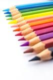 Lápices del color en fila Imágenes de archivo libres de regalías