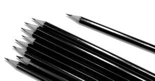 Diversos lápis de tiragem pretos isolados no branco foto de stock royalty free