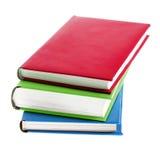Diversos livros brilhantes coloridos no fundo branco Foto de Stock