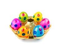 Diversos ovos da páscoa pintados na bandeja do ouro Fotografia de Stock Royalty Free