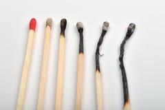 Diversos partidos quemados y solo un uno no quemado en los vagos blancos Imagen de archivo libre de regalías