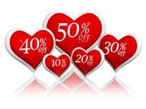Diversos porcentajes del descuento en banderas rojas de los corazones Imagen de archivo