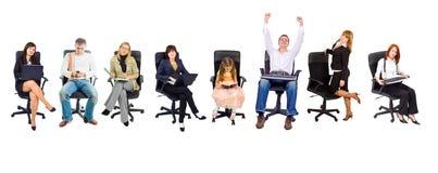 Diversos povos em cadeiras do escritório Imagem de Stock Royalty Free